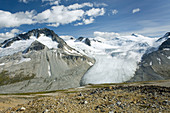 Tongue-like glacier flowing down between Mount Ethelweard left 2819 m 9249 ft and Icemaker Mountain 2745 m 9006 ft, Coast Mountains British Columbia Canada