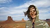 Young woman tourist at Monument Valley Navajo Tribal Park, Arizona & Utah, USA