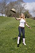 Beautiful young woman having fun outside in a green natural environment
