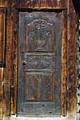 Carved door, Saint-Véran, Queyras Regional Natural Park. Hautes-Alpes, France