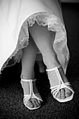 Accessories, Accessory, Adult, Adults, b&w, black-and-white, bride, brides, Contemporary, Cross legged, Crossing legs, detail, details, Dress, Dresses, Feet, Female, Foot, Footgear, Footwear, human, indoor, indoors, interior, Legs crossed, marriage, matri