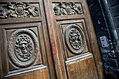 Aged, Carving, cities, city, Closed, Color, Colour, Daytime, detail, details, Door, Doors, Entrance, Entrances, Entries, Entry, Europe, exterior, France, Medusa, Mythology, Old, outdoor, outdoors, outside, Paris, Relief, Reliefs, Sculpture, Sculptures, Wo