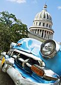 Capitol building and old car, Havana. Cuba