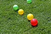 Plastic balls on garden lawn