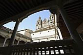La Clerecía (18ht century baroque Jesuit monastery, now Pontifical University of Salamanca) seen from the courtyard of Casa de las Conchas, Salamanca. Castilla-Leon, Spain