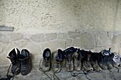 Shoes at pilgrims hostel, Puente la Reina. Navarra, Spain