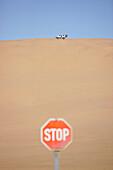 Car driving on sand dunes near Swakopmund, Namibia, Africa