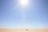 Car travelling through the desert, coastal desert south of Swakopmund, Namibia, Africa