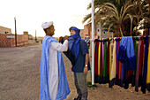 A man buying a berber rag, Zagora, Draa valley, South Morocco, Morocco, Africa