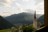 View from the balcony of Hotel Moosmair towards church Ahornach, Sand in Taufers, South Tyrol, Italy