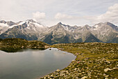Lake Klaussee in the hiking area of Klausberg, view towards Zillertaler Alps, Tauferer Ahrntal, South Tyrol, Italy