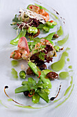 Lobster salad with sugar snaps in restaurant Tilia, Chef Chris Oberhammer, Vintl South Tyrol, Italy