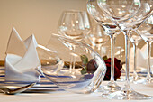Set table with decoration and wine glasses, Restaurant Jasmin Hotel Bischofhof, Klausen, South Tyrol, Italy