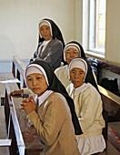Myanmar  Nuns attending  Catholic wedding of tribal Kachins at  Myitkyina, a largely Kachin community in north Burma near the Chinese border