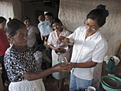 HONDURAS  Woman teaching a womens group to make shampoo from natural organic materials, Marcala