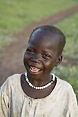 Africa, Child, Children, Color, Colour, Face, Happy, Health, Portrait, Sahara, Smile, Sub, Vertical, D63-763662, agefotostock