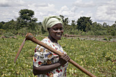 UGANDA  Nejjemba Teopista, farmer of Kayunga and farmers group animator, holding her hoe after working in a communal garden at Kangulumira where food is grown to feed the poor and sick  Caritas Uganda project