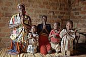 40UGANDA  In the home of Najjemba Teopista, Kasaayi village, Kayunga District  Family praying, from left to right: Teopista, Nakata Maria Goretti, 7, Nankinda Faustea, 13, Waswa Joseph, 7, Lugya Kevin, 5, grandson
