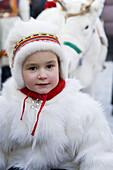 Sami (Lapp) girl in traditional clothes at Winter Fair. Jokkmokk, Northern Sweden