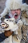 Man wearing fur coat & hat & frost covered moustache & beard at Winter Fair. Jokkmokk, Northern Sweden