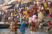 Pilgrims bathing in holy river Ganges, Varanasi, India