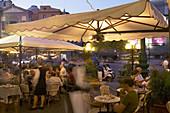Outdoor cafe in Piazza del Plebiscito (aka Piazza Trento e Trieste), Naples, Italy
