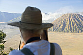 Bromo-Tengger-Semeru National Park, Gunung Bromo Volcano, Java, Indonesia . Man taking photograph of Bromo Volcano