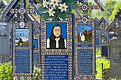 Merry Cemetry each cross has a colourful depection of the desceased life, Sapanta, Maramures, Romania