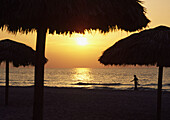Bare, Beach, Carrying, Cuba, Foot, Resort, Shoes, Strolling, Sunset, Tiki, Umbrella, Unrecognizable, Varadero, Walking, Woman, U06-764277, agefotostock