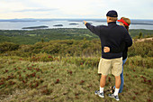 a couple viewing bar harbor from cadillac mountain acadia NP in maine usa