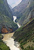 Tiger Leaping Gorge pinyin: Hutiào Xiá is a canyon on the Yangtze River - locally called the Golden Sands River, located 60 km north of Lijiang City, Yunnan in southwestern China