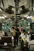 Mumbai India, men traveling on a train from Victoria station