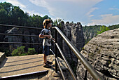 Boy (6 years) looking at view, Bastei, Saxon Switzerland, Elbe Sandstone Mountains, Saxony, Germany