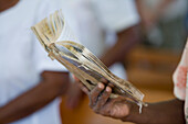 Woman holding hymnbook at church service, Naidi, Vanua Levu, Fiji Islands, South Pacific, Oceania