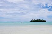 View at distant canoes and Taakoka Motu at Muri Lagoon, Rarotonga, Cook Islands, South Pacific, Oceania
