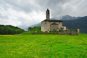 Church in Rossura situated in a meadow, valley Leventina, Ticino, Switzerland