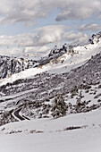 Snowy scenery with road, Dolomites, Trentino-Alto Adige/Südtirol, Italy