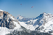 Paragliders above snow-covered Dolomites, Trentino-Alto Adige/Südtirol, Italy