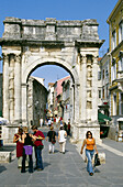 People in front of a gate at the Old Town of Rovinj, Croatian Adriatic Sea, Istria, Croatia, Europe