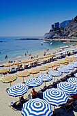 People and sunshades on the beach, medieval tower, Monterosso al Mare, Cinque Terre, Liguria, Italian Riviera, Italy, Europe