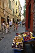 Tourists and a delicatessen in an alley, Portovenere, Liguria, Italian Riviera, Italy, Europe