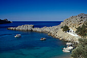 Boats at Agios Pavlos bay in the sunlight, Lindos, Island of Rhodes, Greece, Europe