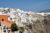 Houses at a mountainside in the sunlight, Oia, Santorini, Greece, Europe