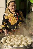 Fresh dumplings are being steamed in a local restaurant in Hami, Xinjiang, west China