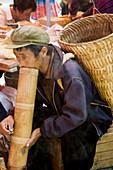 Traditional smoke via a big bamboo pipe in Yunnan province, China