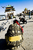 Mongolian nomads visit a famous temple in the capital city of Ulan Batarr