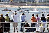 People during Kontxako Bandera (Flag of the Concha) boat race along the Bay of Biscay. Donostia, Guipuzcoa, Euskadi, Spain (September 9th 2007)