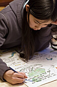 Asian, Black hair, Chinese, Color, Colour, Concentration, Contemporary, Drawing, Focus, Girl, Homework, Project, Study, Work, V01-709386, agefotostock