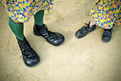 Adult, Adults, Amazon, Amazonas, Anonymous, Big, Boy, Boys, Brazil, Child, Childhood, Children, Circus, Clown, Clowns, Color, Colour, Contemporary, Costume, Costumed, Costumes, Daytime, Disguise, Disguises, Entertainment, Fancy dress, Feet, Foot, Footgear
