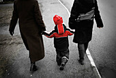 Adult, Adults, Back view, Boy, Boys, Child, Children, Cities, City, Color, Colour, Contemporary, Daytime, Europe, Exterior, Families, Family, Hand holding, Hand in hand, Hand-holding, Hold hands, Holding hands, Human, Kid, Kids, Male, Outdoor, Outdoors, O
